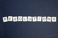 "Scrabble pieces spelling out ""RESOLUTIONS"""