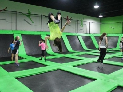 Teenagers jumping at a trampoline park